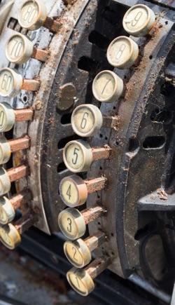 knapper på et antikt kasseapparat